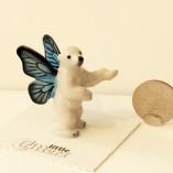 winter pixie polar bear with dime