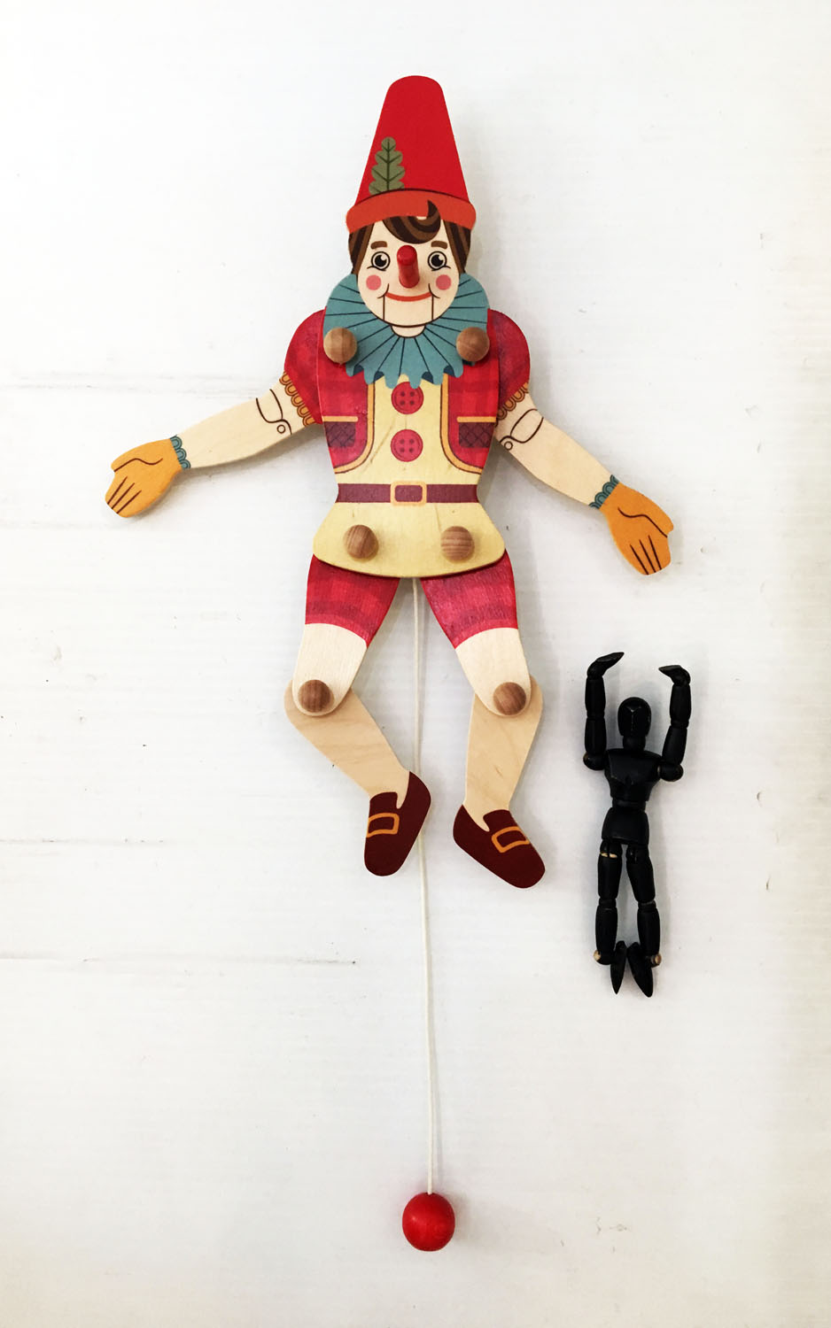 pinocchio wood pull puppet and logo